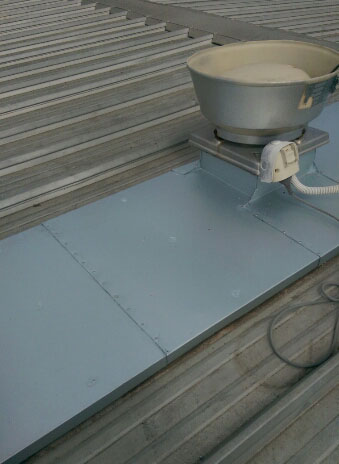 Metal roof leaks repaired with hopper flashing - Brighton