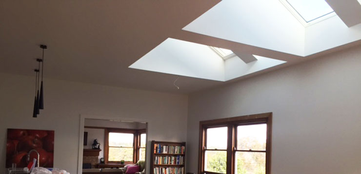 Velux skylights vaulted shafts create an architectural for Architectural skylights