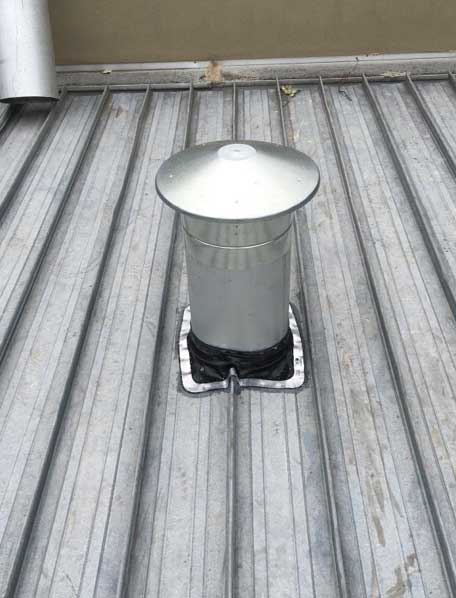 flue and cowl installed for bathroom exhaust fan - Research (image)