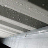 When condensation forms under metal roofs it is often mistaken for a metal roof leak (image)