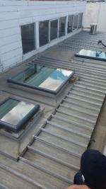 Acrylic dome skylights have been replaced by Velux glass skylights (image)