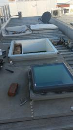 Acrylic skylight dome replacement underway with Velux glass skylight (image)