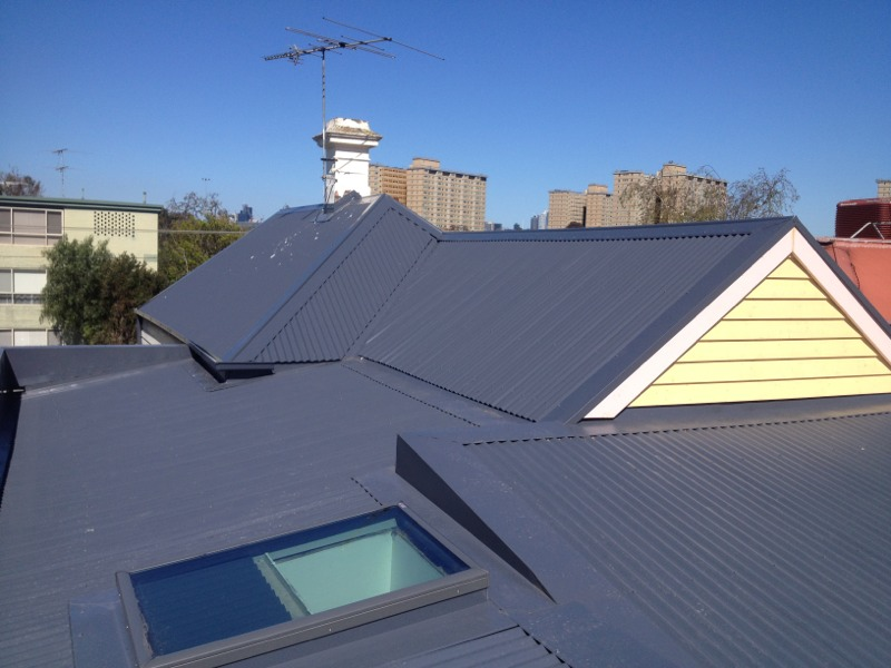 Colorbond metal reroof with Velux Skylight in Flemington - Rear Finished (image)