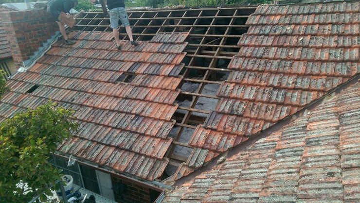 Removing tiles to replace with Colorbond steel roof -- Heidelberg Heights (image)