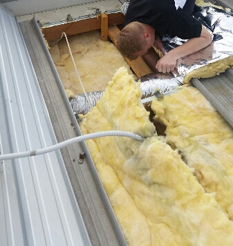 Insulation installed into flat roof - Melbourne (image)