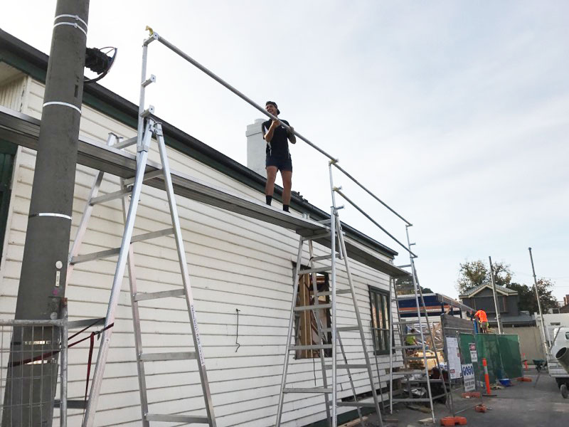 Roof plumbers setting up for safe access - Albert Park (image)