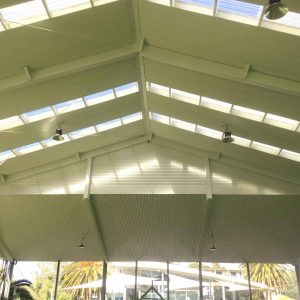 Corrugated wall cladding and flashings installed - Tennis Pavillion (image)