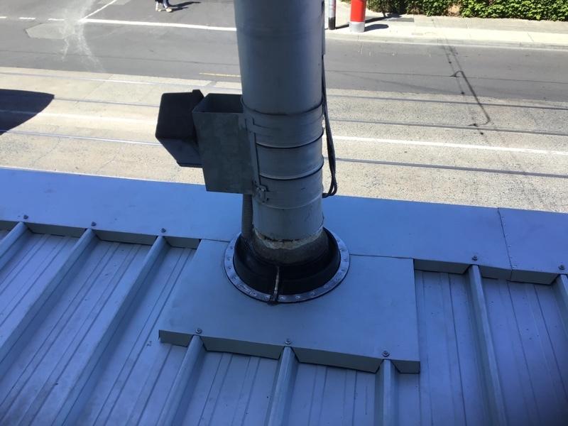 Replace Shopfront Metal Verandah Roof Thornbury | Power Pole Penetration After | Melbourne | Roofrite
