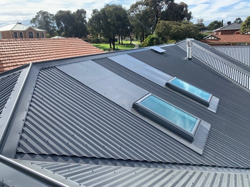 Tile to metal reroof with Velux Skylight install (image)