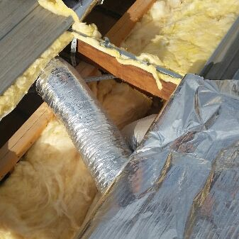 Insulation batts and foil installed into flat roof - Melbourne (image)
